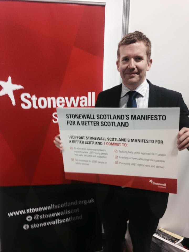 160312 SNP Conference Stuart McDonald with Stonewall Manifesto.jpg
